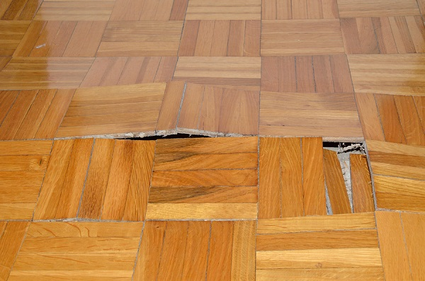 water damaged parquet floor