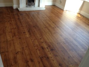 Pine floor after sanding and staining