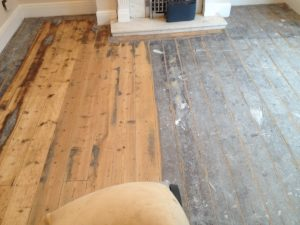 Pine floor during sanding and staining