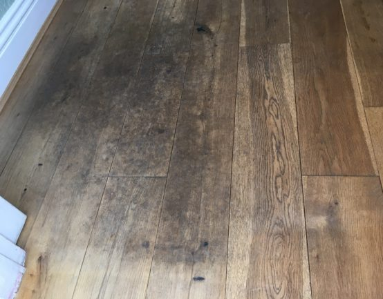 scratched and damaged oak floor